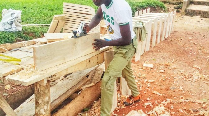 Corp member commended for constructing many desk for students with his learned carpentry skill. (More photos attached).
