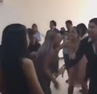 Woman scatters wedding as she slap bride after telling the groom how much she love him (watch video)